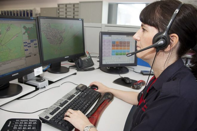 A lady from the emergency services in Wales on duty and taking a call.